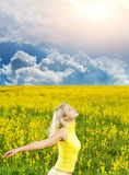 Woman in a flower field Royalty Free Stock Images