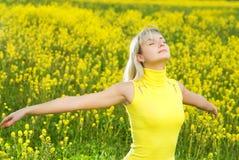 Woman in a flower field Stock Photo