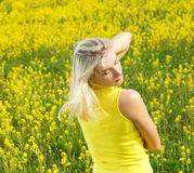 Woman in a flower field Stock Photography
