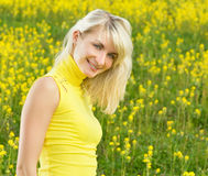 Woman in a flower field Royalty Free Stock Photography