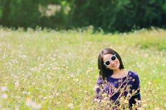 Woman in flower field. Asian woman in golden dried grass field. Girl in flower field stock photo
