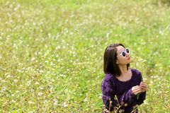 Woman in flower field. stock photo