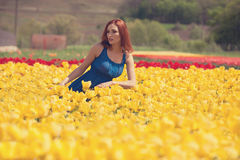 Woman in flower field Royalty Free Stock Photography