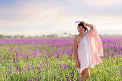 Woman on flower field Royalty Free Stock Photography