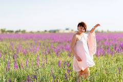Woman on flower field Stock Images