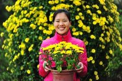 woman in flower garden Stock Images
