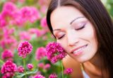 Woman in flower garden Stock Photography