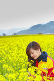 Woman in flower garden. Portrait face closeup Royalty Free Stock Photography