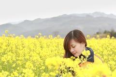 Woman in flower garden. Portrait face closeup Royalty Free Stock Photos