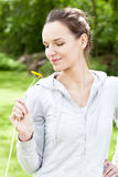 Woman with flower in a garden Royalty Free Stock Photography