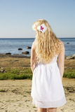 Woman with flower in gold hairs Royalty Free Stock Image