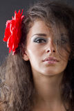 Woman with flower in hair Stock Images