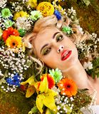 Woman  with flower hairstyle. Stock Photos