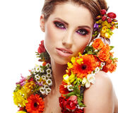 Woman with flower hairstyle Royalty Free Stock Image