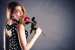 Woman with a flower in hand. Beautiful woman with a flower in hand Royalty Free Stock Photos