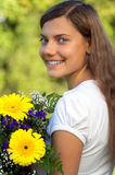 Woman flower happiness. Young woman enjoy bouquet of flowers in her hands stock image