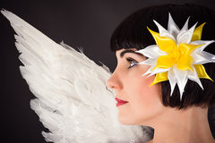 Woman with a flower on the head and angel wings Stock Photos