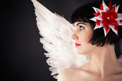 Woman with a flower on the head and angel wings Stock Image