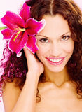 Woman with flower in her curl hair. Portrait of a woman with flower in her curl hair Stock Photos