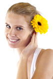 Woman with flower in her hair. Beautiful angelic woman with flower in her hair over white Stock Photos