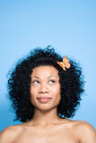 Woman with flower in her hair Royalty Free Stock Images