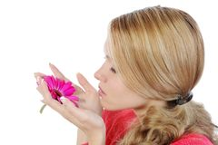 Woman with flower in her hand Royalty Free Stock Photography