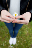 Woman with a flower in her hand. Stock Photo