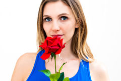 Woman with a flower in her hands. Beautiful young woman with a flower in her hands Stock Image