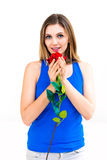 Woman with a flower in her hands. Beautiful young woman with a flower in her hands Royalty Free Stock Images