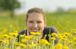 Woman on a flower meadow Stock Images