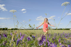 Woman on flower meadow Royalty Free Stock Image