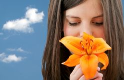 Woman with a flower outdoors Royalty Free Stock Photo