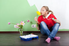 Woman with flower and paint roller in hands Royalty Free Stock Photo