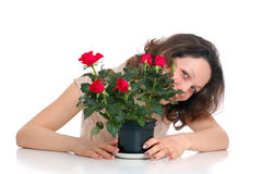 Woman with flower pot Royalty Free Stock Photography