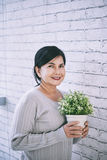 Woman with flower pot Stock Image