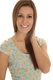 Woman flower shirt hand neck smile Royalty Free Stock Photos