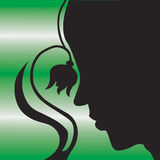Woman and flower silhouette. Black side portrait silhouette of woman with flower and curling stem, decorative green background Stock Photos
