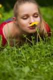 Woman with flower. Woman smelling a flower closed eyes Royalty Free Stock Images