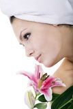 Woman with flower  in spa. Royalty Free Stock Photo