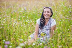 Woman in flower wild stock image