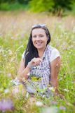 Woman in flower wild Stock Photography