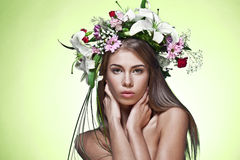 Woman with flower wreath. Stock Photo