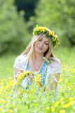 Woman with flower wreath Stock Photo