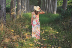 Woman with flowered dress and summer hat Royalty Free Stock Photos