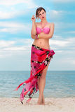 Woman in flowered pareo. Pretty woman in flowered pareo posing on the beach Royalty Free Stock Image