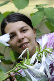 Woman in flowers Royalty Free Stock Photography