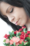 Woman with flowers. Beautiful woman smelling the flowers. Close up Royalty Free Stock Photos