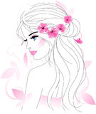 Woman with flowers. Beautiful young woman with pink flowers Stock Photo