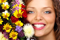 Woman and flowers royalty free stock photography