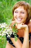 Woman and flowers Royalty Free Stock Image